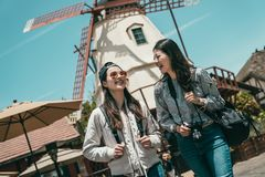 Friends talking happily while sightseeing stock images