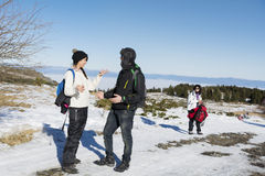 Friends talking in the winter mountain.Winter fun Royalty Free Stock Photo