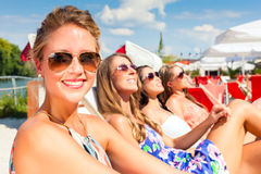 Friends tanning in beach bar Royalty Free Stock Photo