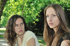 Friends (teenage girls) in conflict. Friends outdoors series - one girl is offended and  second wants make a peace Royalty Free Stock Photography