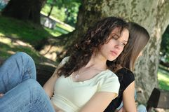 Friends (teenage girls) in conflict. Friends outdoors series - two teenage girls are angry due to ther conflict Stock Image