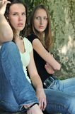 Friends (teenage girls) in conflict. Friends outdoors series - two teenage girls are angry due to ther conflict Stock Photo