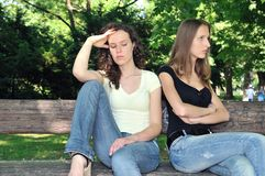 Friends (teenage girls) in conflict. Friends outdoors series - two teenage girls are angry due to ther conflict Stock Photos