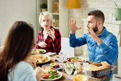 Free Friends Telling Stories At Dinner Royalty Free Stock Photos - 100974598