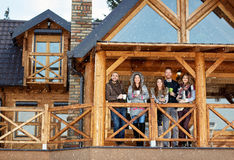 Friends on terrace of mountain house Royalty Free Stock Images