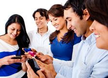 Friends text messaging Stock Photo