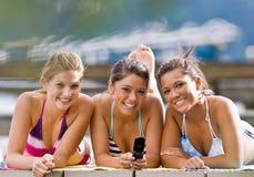 Friends text messaging Stock Photos