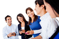 Friends texting on mobiles Stock Photography