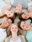 Friends with their heads together smiling Royalty Free Stock Image