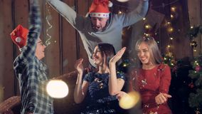 Friends throw confetti in the air at Christmas time. stock footage