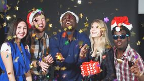 Friends throwing glitter confetti and makes selfie at Christmas party. Slow motion. Friends throwing glitter confetti and makes selfie at Christmas party stock footage