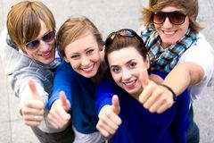 Friends with thumbs up Royalty Free Stock Images