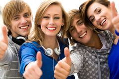 Friends with thumbs up Stock Photo