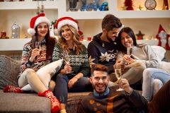Friends toast and celebrating Christmas at home Royalty Free Stock Images