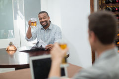 Friends toasting beer glasses Royalty Free Stock Image