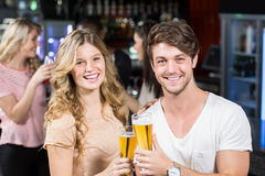 Friends toasting with beer Stock Image