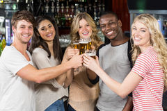 Friends toasting with beer Stock Images