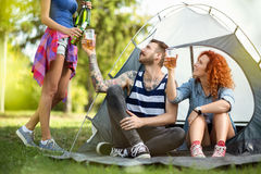 Friends toasting at camp Stock Photography
