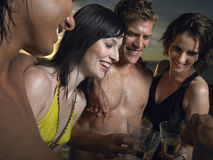 Friends Toasting Champagne Outdoors Stock Photography