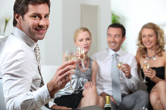 Friends toasting with champagne. Friends toasting success with champagne Royalty Free Stock Photography