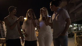 Friends toasting with coffee cups in night street stock video