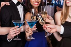 Friends toasting drinks at nightclub Royalty Free Stock Image
