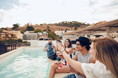 Friends toasting drinks at party Royalty Free Stock Photos