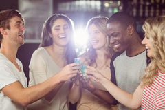Friends toasting with shots Stock Image