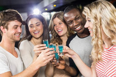 Friends toasting with shots Stock Images