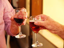Friends toasting with two glasses of red wine Stock Photo