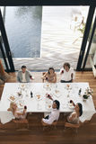 Friends Toasting Wine At Dinner Party Stock Photo