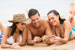 Friends together beach royalty free stock images