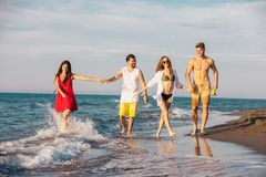 Friends together on the beach having fun. Group of friends together on the beach having fun Royalty Free Stock Image