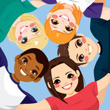 Friends Together Circle. Five happy young smiling teenagers embracing together in circle from low angle view Stock Photo