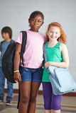 Friends together on schoolyard Royalty Free Stock Image
