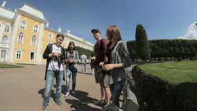 Friends tourists are photographed in the park the Upper Garden, Peterhof, Saint Petersburg, Russia stock video