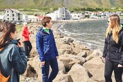 Friends of tourists strolling near the sea Royalty Free Stock Photo