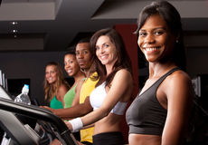 Friends on treadmills. A group of friends on treadmills doing cardio Stock Photography