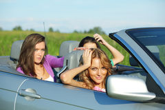 Friends trip in cabriolet Royalty Free Stock Photos