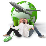 Friends trip organization. A pair of female friends with an online international travel booking background Stock Photo