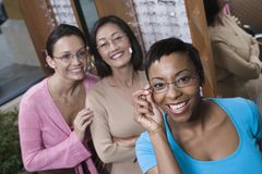 Friends Trying On Glasses At Optometrist Royalty Free Stock Photography