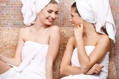 Friends in Turkish sauna. Two attractive girl friends in Turkish sauna Royalty Free Stock Photos