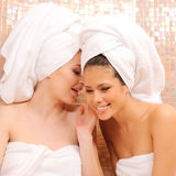 Friends. Two young girls gossiping in Turkish sauna Stock Image