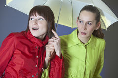Friends under umbrella Stock Image