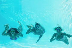 Friends underwater in swimming pool Royalty Free Stock Images