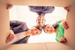Friends unpacking boxes Royalty Free Stock Image