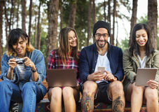 Friends Using Digital Device Outdoors Concept stock photo