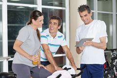 Friends Using Digital Tablet In Gym Royalty Free Stock Photos
