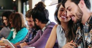 Friends using digital tablet. In restaurant stock video footage