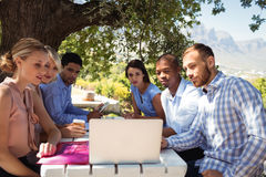 Friends using laptop in restaurant Royalty Free Stock Image